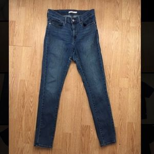 Levi's butt ripped slimming skinny jeans